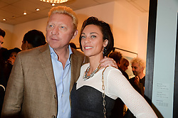 BORIS BECKER and his wife LILLY BECKER at a private view of Photographs by Julian Lennon held at The Little Black Gallery, 13A Park Walk, London SW10 on 17th September 2013.