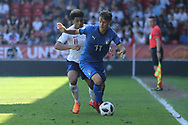 Xavier Amaechi of England (11) and Andrea Mattioli of Italy (11) during the UEFA European Under 17 Championship 2018 match between England and Italy at the Banks's Stadium, Walsall, England on 7 May 2018. Picture by Mick Haynes.