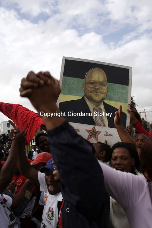 DURBAN - 12 November 2005 - Supporters of South Africa's axed deputy president Jacob Zuma protest outside the Durban Magistrate's Court where a trial date was due to be set. Zuma is accused of accepting a R500,000 bribe from a French arms manufacturer. Picture: Giordano Stolley/Allied Picture Press/APP