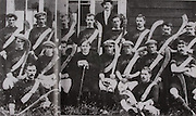 "Kilkenny (Mooncoin)-All-Ireland Hurling Champions 1907. Back Row: Jack Keoghan, Jack Rochfort, Tom Kenny, Dan Stapleton, Danny O'Connell, PAddy ""Icy"" Lannigan, John T Power, Dick Brennan, Sim Walton. Middle Row: Eddie Doyle, Dick Doherty, Mick Doyle, Rev J B Dollard, R ""Drug"" Walsh (capt), Jim Kelly, Dick Doyle, Dan Kennedy. Front Row: Matt Gargan, Jack Anthony. Dick Brennan did not play in final. Dan Grace was absent for photograph."