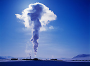 Towering plume of steam backlit by sun above Pump Station 3 on the Trans Alaska Pipeline, subzero winter day in March, North Slope, Alaska.
