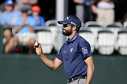March 10, 2017 - Palm Harbor, Florida, U.S. - DOUGLAS R. CLIFFORD   |   Times.Adam Hadwin acknowledges the crowd moments after making a birdie at #17 while playing in the second round of the Valspar Golf Championship at Innisbrook Resort and Golf Club's Copperhead Course on Thursday (3/9/17) in Palm Harbor. (Credit Image: © Douglas R. Clifford/Tampa Bay Times via ZUMA Wire)