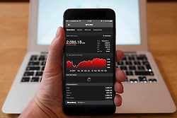 Using iPhone smartphone to display chart of performance of S&P, (SPX) Standard and Poor, stock mark index