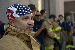 September 11, 2016 - U.S. - ASEC -- Albuquerque Fire Department Commander Paguale Gallucci wears a flag bandana before participating in the stair climb in the 22-story Bank of Albuquereque to honor the 343 firefighters lost in the 9/11 attack. Firefighters from the Albuquerque Fire Department, Bernalillo County Fire Department, Santa Fe County Fire Department and Espanola Fire Department climbed the stairs five times (the equivalent of the 110-story World Rade Cdnter) on Sunday, September 11, 2016. (Credit Image: © Greg Sorber/Albuquerque Journal via ZUMA Wire)