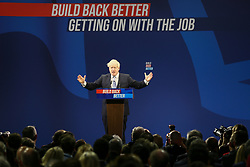 © Licensed to London News Pictures. 06/10/2021. Manchester, UK.  Prime Minister Boris Johnson delivers his keynote speech on the final day of the 2021 Conservative Party Conference. Photo credit: Adam Vaughan/LNP