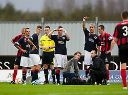 Falkirk players with Craig Sibbald (on ground, hidden) who was taken off with a suspected broken ankle..Falkirk 1 v 0 Queen of the South, 15/10/2011..Pic © Michael Schofield.