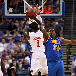 Mar 19, 2011; Tampa, FL, USA; Florida Gators guard Kenny Boynton (1) shoots over UCLA Bruins center Joshua Smith (34) during second half of the third round of the 2011 NCAA men's basketball tournament at the St. Pete Times Forum. Florida defeated UCLA 73-65.  Mandatory Credit: Derick E. Hingle