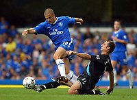 Photograph: Scott Heavey.<br />Chelsea v Leicester City, from Stamford Bridge. 23/08/2003.<br />Riccardo Scimeca dives in on Joe Cole and earns him a red card.