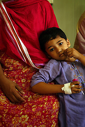 A young patient rests inside the Children's Hospital at the Pakistan Institute of Medical Sciences, P.I.M.S., in Islamabad, Pakistan on Sept. 19, 2007.
