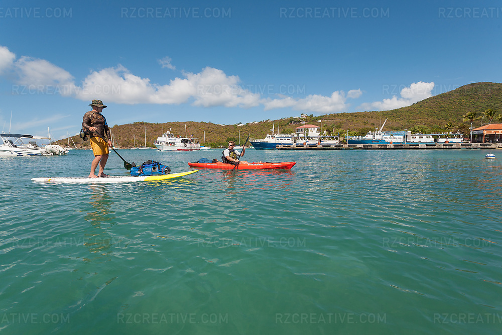 Standup paddler Ted Rutherford and Mark Anders paddle into Cruz Bay/Galge Cove on the island of St. John, U.S. Virgin Islands. © Robert Zaleski / rzcreative.com<br /> —<br /> To license this image contact: robert@rzcreative.com