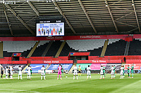 Football - 2019 / 2020 Championship - Swansea City vs Sheffield Wednesday<br /> <br /> Both teams clap before ko sign showing july 5 birthday of ohs in background<br /> in a match played with no crowd due to Covid 19 coronavirus emergency regulations, at the almost empty Liberty Stadium.<br /> <br /> COLORSPORT/WINSTON BYNORTH