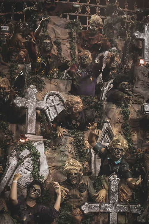 Performers in lavish and creative costumes ride on a parade float featuring a cemetery in the Sambodrome during Carnival in Rio de Janeiro, Brazil. (March 3, 2019)