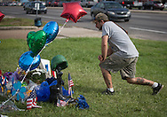 Matthew Saia at a makeshift memorial where six oifficers were shot on Airline Highway in Baton Rouge. Three of the officers were killed and another one remains in criticial condition. The memorial in front of the  B-Quik gas station continues to grow.