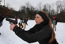 A member of Hillary Clinton's security detail takes part in training drills at a training facility in Summit Point, W.Va on Dec. 17, 2011.
