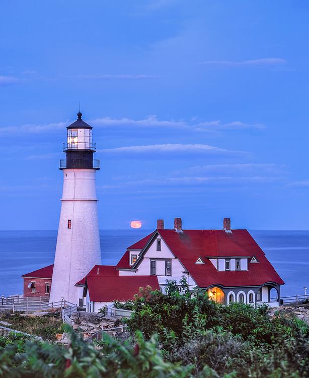 Portland Head Light, lighthouse shining at dusk, full moon rise, Portland, ME