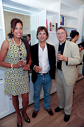 Left to right, JENNIFER SPRING, ADAM NICHOLL and FR.MICHAEL SEED at a reception to celebrate the repairs on the Queen Elizabeth Gate in Hyde Park after it's successful repair following damaged sustained in a traffic accident in early 2010.  The party was held at 35 Sloane Gardens, London on 7th June 2010.