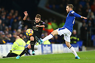 Marc Albrighton of Leicester City passes the ball as Gylfi Sigurdsson of Everton attempts to block. Premier league match, Everton v Leicester City at Goodison Park in Liverpool, Merseyside on Wednesday 31st January 2018.<br /> pic by Chris Stading, Andrew Orchard sports photography.