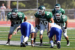 17 September 2011: Illinois Wesleyan football players Joe Schneider, J.J. Marren, and Mike Kraft during an NCAA Division 3 football game between the Aurora Spartans and the Illinois Wesleyan Titans on Wilder Field inside Tucci Stadium in.Bloomington Illinois.