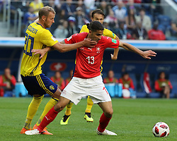 July 3, 2018 - Russia - July 03, 2018, St. Petersburg, FIFA World Cup 2018 Football, the playoff round. Football match of Sweden - Switzerland at the stadium of St. Petersburg. Player of the national team.. Ola Toivonen; Ricardo Rodriguez. (Credit Image: © Russian Look via ZUMA Wire)