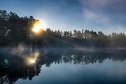 Misty sunrise over Lake Rohunta, Athol, Massachusetts, USA.