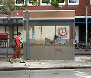 Have I got views for loo! Artist camouflages public toilets and other ugly structures so they're hidden against their backgrounds<br /> <br /> An artist has transformed ugly run-down public structures into works of art by camouflaging them into their background using paint.<br /> Dutch designer Roeland Otten has used mosaics, geometric paint designs, and high resolution photograph wall coverings to recreate the otherwise blocked and lost views of the city streets.<br /> He has managed to turn an air quality measuring station, an electricity substation and a public toilet in Amsterdam into artistic creations.<br /> His aim is to disguise eyesores on picturesque urban streets and pathways and rejuvenate the area by doing so.<br /> <br /> His City Camouflage project, featured in Dezeen magazine, includes a pixelated view of Jan van Galenstraat shopping street in Amsterdam using tiles.<br /> Otten's project began in 2009 with the transformation of a former electricity substation on the corner of Graaf Floristraat and Heemraadsingel in Rotterdam.<br /> <br /> He decorated the building in sheets of aluminium printed with high-resolution photographs of the surrounding streets, so that it seemed almost invisible among the houses and trees.<br /> Last year he used acrylic paint to transform a rusty electricity substation on the Boompjeskade waterfront in Rotterdam.<br /> The bold graphic paintwork makes the substation blend in with the water and foliage nearby.<br /> An old public toilet building used to measure the quality of the air was used for another part of the project, which you can find out more about atwww.roelandotten.com.<br /> ©exclusivepix