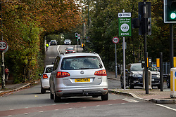 Licensed to London News Pictures. 24/10/2021. London, UK. Cars cross the South Circular at Putney today into what will be the new ULEZ expanded area tomorrow. On Monday 25th October the London Ultra-Low Emission Zone (ULEZ) area will expand to inside the North and South Circular with many drivers of older cars forced to pay a daily £12.50 fee or face heavy fines of £160.00. Photo credit: Alex Lentati/LNP