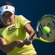 August 16, 2014, New Haven, CT:<br /> Kurumi Nara hits a backhand during a match against Samantha Stosur on day four of the 2014 Connecticut Open at the Yale University Tennis Center in New Haven, Connecticut Monday, August 18, 2014.<br /> (Photo by Billie Weiss/Connecticut Open)