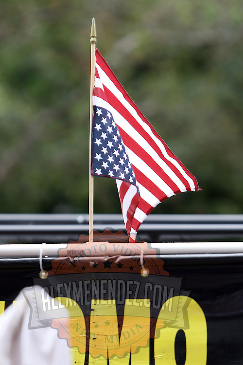 An upside down American flag is part of the Bible Believers protest during the Republican National Convention in Tampa, Fla. on Wednesday, August 29, 2012. (AP Photo/Alex Menendez)