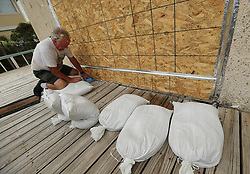 Richard Fine makes final preparations boarding up and sandbagging a beachfront home before Hurricane Irma arrives on Saturday, September 9, 2017, on Tybee Island, Ga. Photo by Curtis Compton/Atlanta Journal-Constitution/TNS/ABACAPRESS.COM