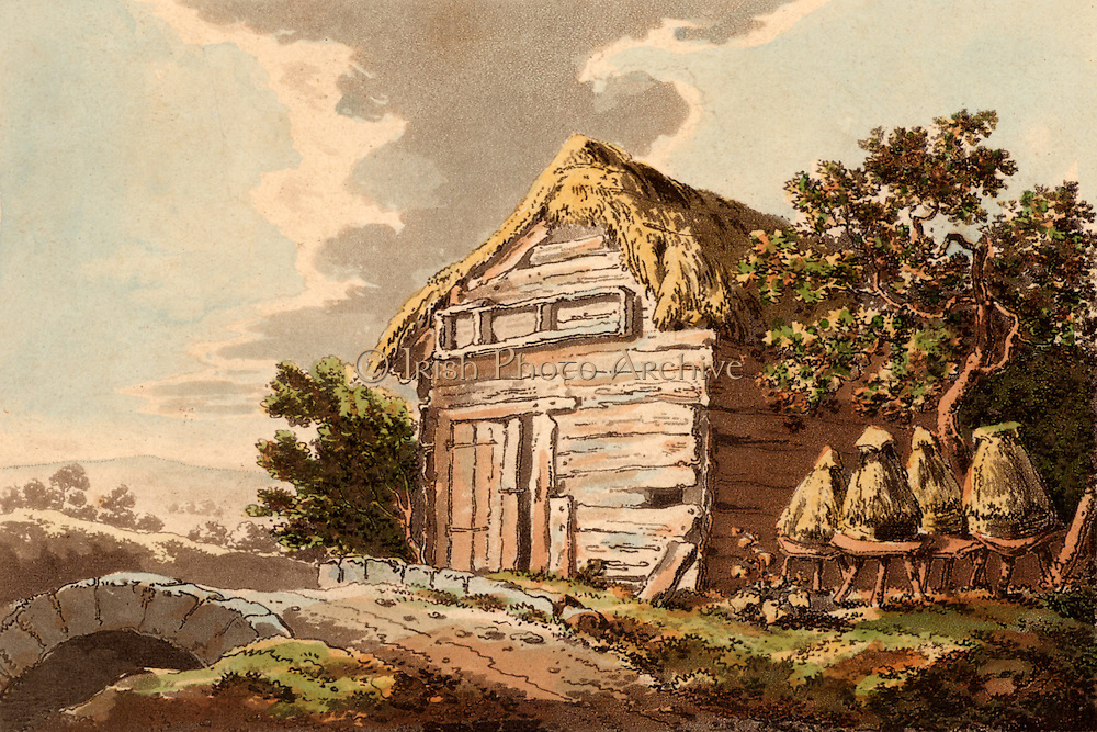 Straw bee skeps by a rustic barn. Aquatint published London, 1795.