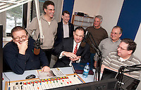 """WEZS talk radio host Niel Young welcomes Congressman Frank Guinta to the 15th year airing of the """"The Advocates"""" Saturday morning. Looking on are former Franklin Mayor Tony Giunta, Franklin Mayor Ken Merrifield, City Councilor Robert Hamel, NH State Rep. Harry Accornaro and Rep. Paul Hopgarten.  (Karen Bobotas/for the Laconia Daily Sun)"""