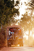 People overload a truck for transport on the road to Morondava, Madagascar