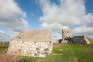 Loophole tower at Rousse, Vale, with powder magazine in foreground. This is one of 15 such towers built on the island in 1778-79. Guernsey, Channel Islands © Rudolf Abraham