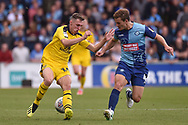 Oxford United midfielder Gavin Whyte (16) battles for possession  with Wycombe Wanderers midfielder Dominic Gape (4) during the EFL Sky Bet League 1 match between Wycombe Wanderers and Oxford United at Adams Park, High Wycombe, England on 15 September 2018.
