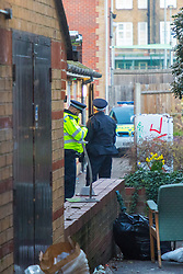 Police guard the scene of yet another fatal stabbing in London where a man believed to be in his 20s or 30s was fatally wounded in what appears to be a squat on Globe Road in Stepney, London. London, February 26 2019.