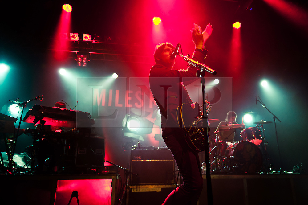 """© Licensed to London News Pictures. 28/04/2012. London, UK. Miles Kane performs live at the HMV Forum.  Miles is an English musician originally from Meols on the Wirral, best known as the co-frontman of The Last Shadow Puppets (along with Alex Turner of the Arctic Monkeys ) and former frontman of The Rascals.  Miles is promoting his debut solo album """"Colour of the Trap"""".  L to R - Ben Parsons, Miles Kane, Jay Sharrock.  Photo credit : Richard Isaac/LNP"""