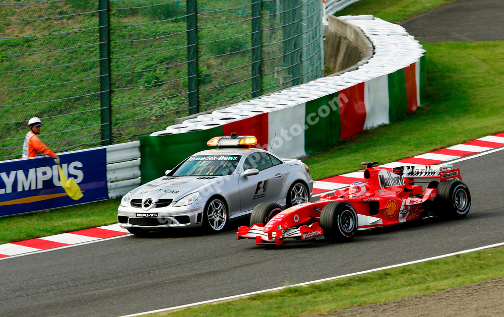 Rubens Barrichello (Ferrari) passes the safety car (despite yellow flags) during the early stages of the 2005 Japanese Grand Prix in Suzuka. Photo: Grand Prix Photo