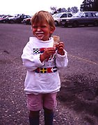 A293Y6 Boy toddler child making a mess on face with ice cream