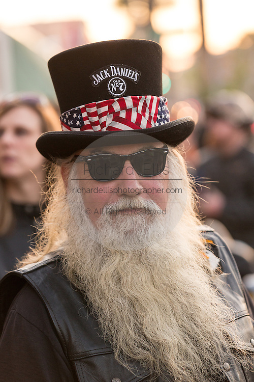 A bearded biker wearing a top hat during the 74th Annual Daytona Bike Week March 8, 2015 in Daytona Beach, Florida. More than 500,000 bikers and spectators gather for the week long event, the largest motorcycle rally in America.