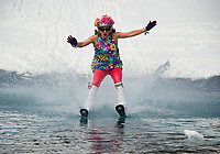 "Go-Go dancer Jennifer Kelley comes in ""hot"" during the BYODC pond skim at Gunstock on Saturday.  (Karen Bobotas/for the Laconia Daily Sun)"
