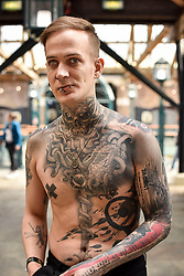 © licensed to London News Pictures. 25/09/2015<br /> The 11th London International Tattoo Convention, one of the most prestigious body art conventions in the world, brought together 400 of the best tattoo artists to thousands of admirers at Tobacco Dock. Other attractions and alternative performances included burlesque, sword swallowing, striptease dancers, fire-dancers and trapeze performers. Pictured Neon Judas from Berlin.<br /> Photo credit : Ian Whittaker/LNP