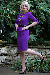 © licensed to London News Pictures. London, UK 13/11/2012. Claire Alsop, 31, from Rotherham in South Yorkshire, posing to show her new shape as she slimmed down from 21st 9lb to a 10st 1½lb. Now she's been named Slimming World's Woman of the Year 2012. Photo credit: Tolga Akmen/LNP