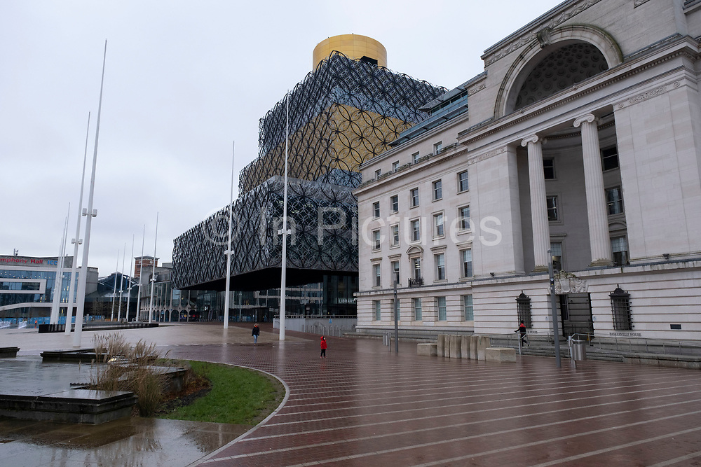 National coronavirus lockdown three begins in Birmingham city centre at Centenary Square, which is deserted apart from a woman and child on 6th January 2021 in Birmingham, United Kingdom. Following the recent surge in cases including the new variant of Covid-19, this nationwide lockdown, which is an effective Tier Five, came into operation today, with all citizens to follow the message to stay at home, protect the NHS and save lives.