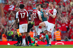 (left to right) Arsenal's Alex Iwobi, Arsenal's Calum Chambers ad Arsenal's Per Mertesacker celebrate after the final whistle