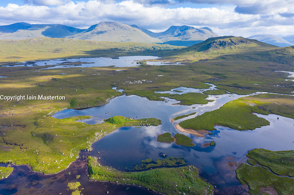 Aerial view of Lochan na Stainge on Rannoch Moor in summer, Grampian Mountains in distance, Scotland, UK