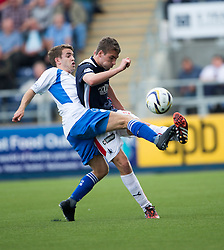 Queen of the South's Daniel Carmichael and Falkirk's Luke Leahy.<br /> Half time : Falkirk 0 v 0 Queen of the South, Scottish Championship game played today at The Falkirk Stadium.