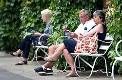 Racegoers wait for the start of the action at Thirsk Racecourse, Thirsk.