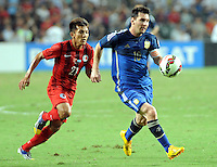 Lionel Messi of Argentina, right, challenges Kwok Kin-pong of Hong Kong during a friendly football match in Hong Kong, China, 14 October 2014.<br /> <br /> Lionel Messi needed just six minutes to make his mark in Argentina's 7-0 rout of Hong Kong in a friendly at Hong Kong Stadium on Tuesday (14 October 2014). The Barcelona star Messi scored twice after going on as a substitute for the last 30 minutes of the game to celebrate the 100th anniversary of the Hong Kong Football Association. Napoli striker Gonzalo Higuain and Benfica's Nicolas Gaitan also scored two goals each after Sevilla's Ever Banega had opened scoring in the 19th minute.