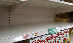 © Licensed to London News Pictures. 20/09/2021. London, UK. Nearly empty shelves of cereals in Sainsbury's in north London as fears of food shortages grow after two of the UK's biggest Carbon Dioxide (CO2) producers halted production last week due to soaring gas prices. Photo credit: Dinendra Haria/LNP