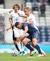 UEFA Euro 2020 Championship Group D match between Scotland v Czech Republic Hampden Park on June 14, 2021 in Glasgow, Scotland<br /> <br /> Scotland's John McGinn gets to the ball ahead of Vladimir Darida with Alex Kral in the background (21)<br /> <br /> Credit: COLORSPORT/Ian MacNicol